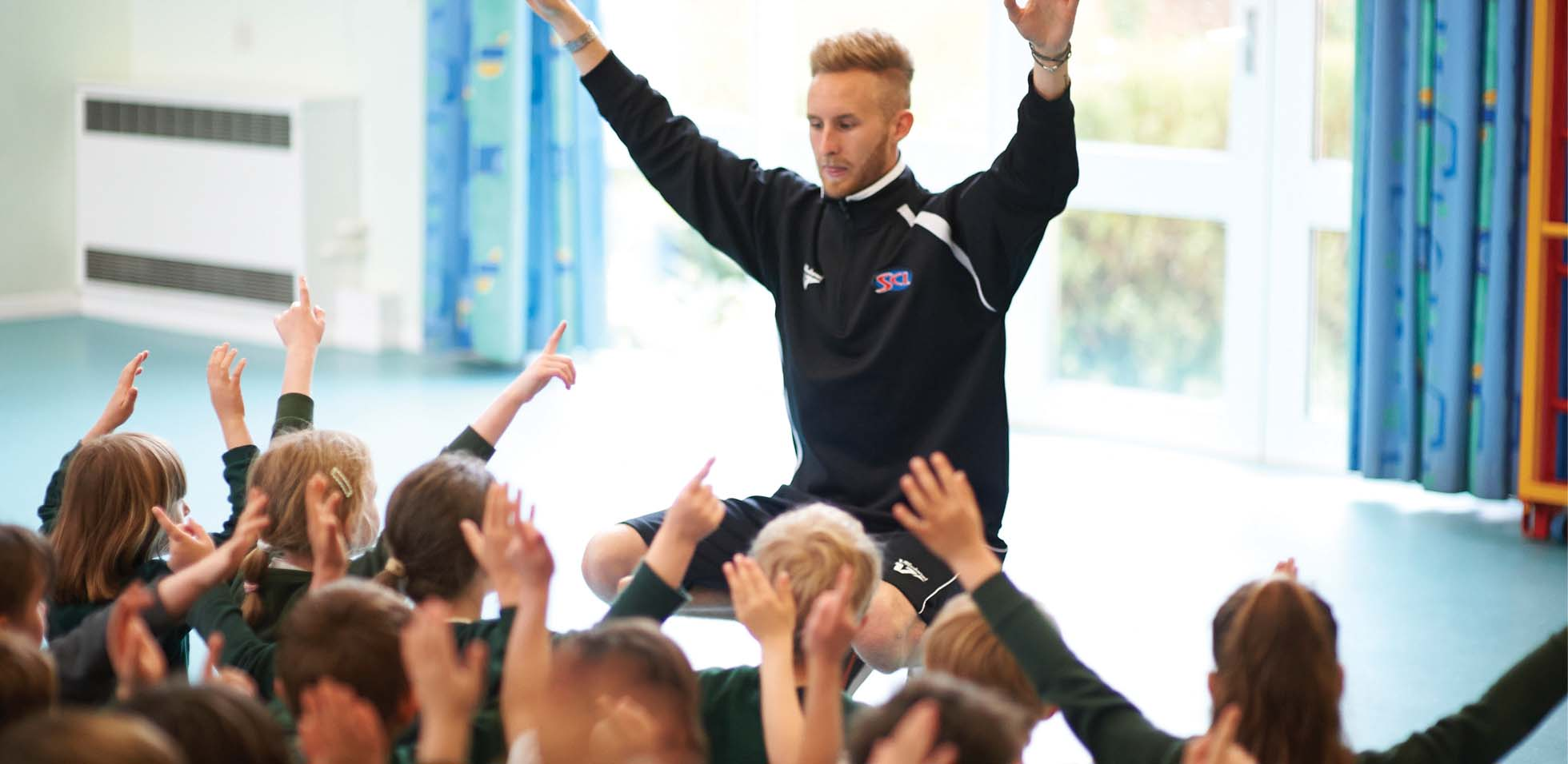 An SCL coach providing a sports session at a primary after school club